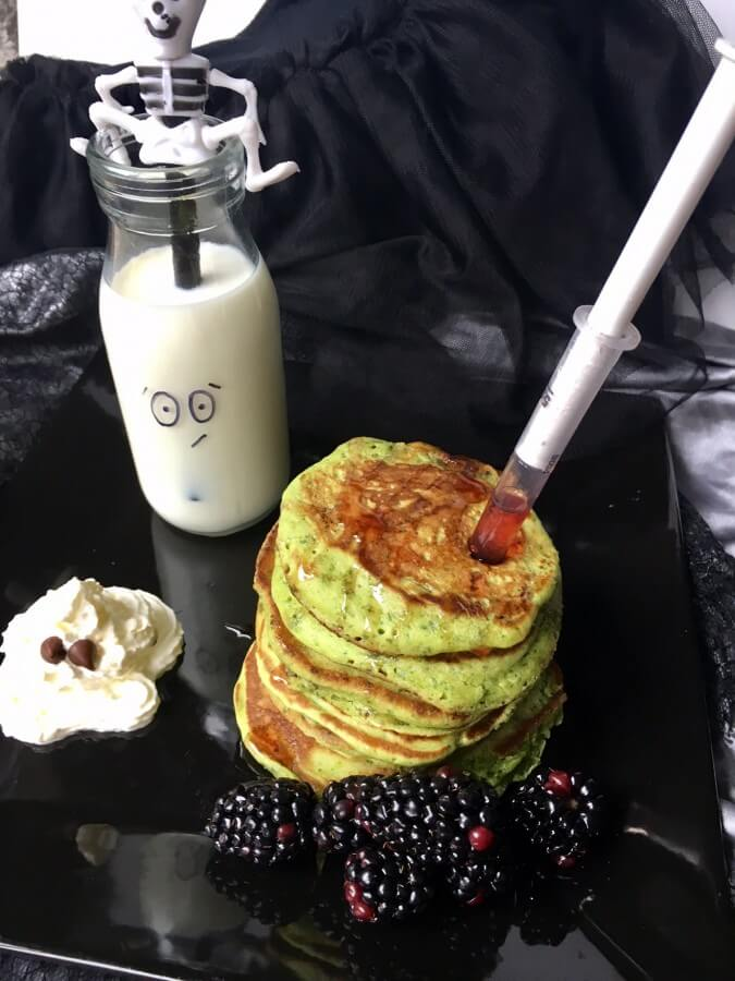 Witches spinach pancakes with witches blood strawberry sauce syringes, ghost cream, ghoul milk and poisonous blackberries
